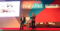 Kevin McCloud (far right) on stage at the Grand Designs Live Grand Theatre.
