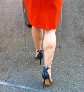 woman in high heels walking on crutches