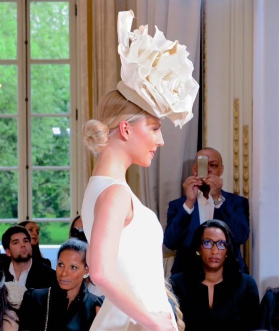 model in rose-shaped hat at Isabell Kristensen's 2017 Royal Ascot Couture Collection