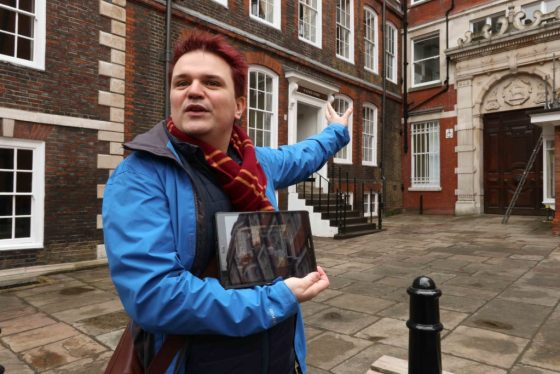 """BritMovieTours guide Dewi Evans offers walking tours of """"The Crown"""" film locations in London. Here, he motions toward 4 Essex Court in Middle Temple, which stood in for the entrance to Lord Altrincham's office in the Season Two episode """"Marionettes."""" © Amy Laughinghouse"""
