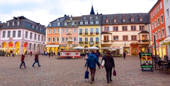 The Hauptmarket in Trier showcases a variety of architectural styles. Zum Domstein, which serves a special Roman dinner, stands beside Germany's oldest pharmacy. Copyright Amy Laughinghouse.