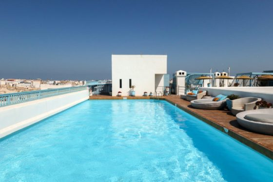 At Heure Bleue Palais hotel, a rooftop terrace with a pool and restaurant offer fantastic views over Essaouira. Copyright Amy Laughinghouse.