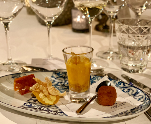 a plate of appetisers served with wine