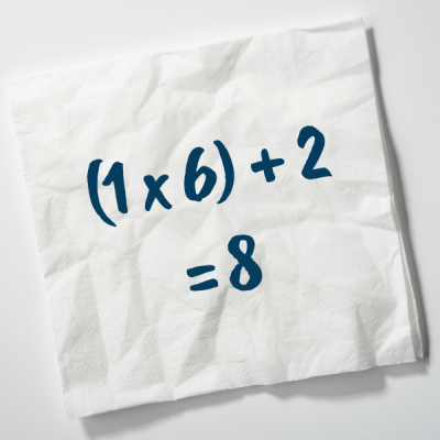 wrinkled napkin with math equation written on it