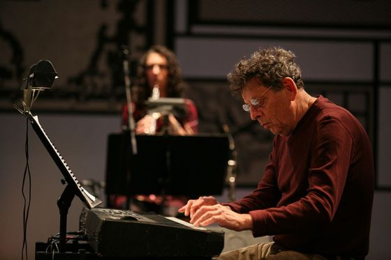 Philip Glass, shown in this picture at a 2008 performance in Milan, has achieved success in both the classical and film worlds.  Photo by Flickr user MITO SettembreMusica