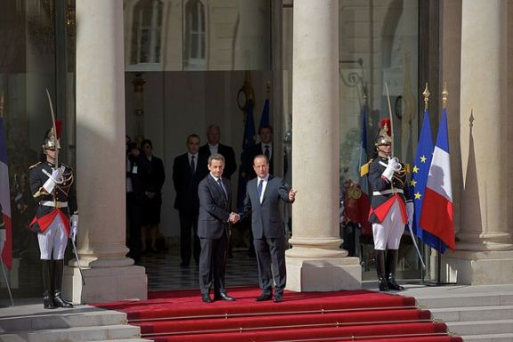 Incoming president François Hollande is greeted by outgoing president Nicolas Sarkozy at the Élysée Palace on May 15, 2012 as part of the inauguration ceremonies for Hollande.  Photo by Wikipedia user Cyclotron
