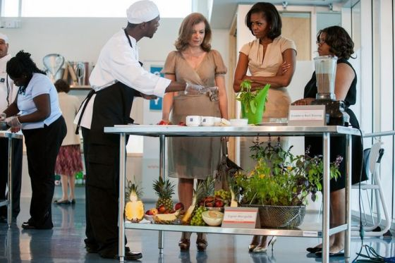 France's effective first lady, Valérie Trierweiler, joins U.S. First Lady Michelle Obama for a cooking demonstration at the Gary Comer Youth Center in Chicago during an official visit in May 2012.  White House photo by Lawrence Jackson
