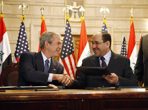 U.S. President George W. Bush (left) and Iraqi Prime Minister Nouri Al-Maliki (right) at a press conference in Baghdad in December 2008. White House photo by Eric Draper