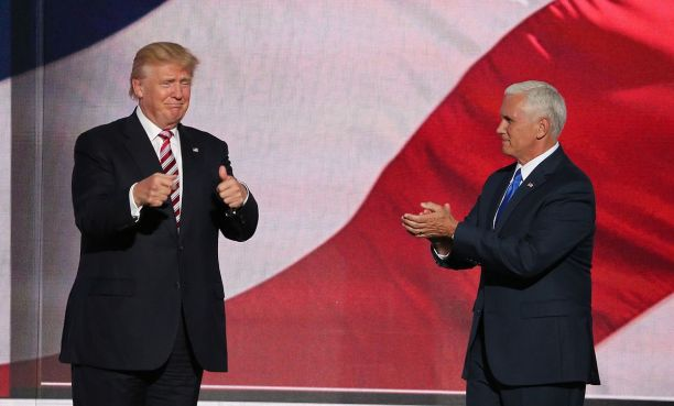 Donald Trump appears on stage with running mate Mike Pence at the 2016 Republican National Convention. Photo by Ali Shaker for Voice of America.