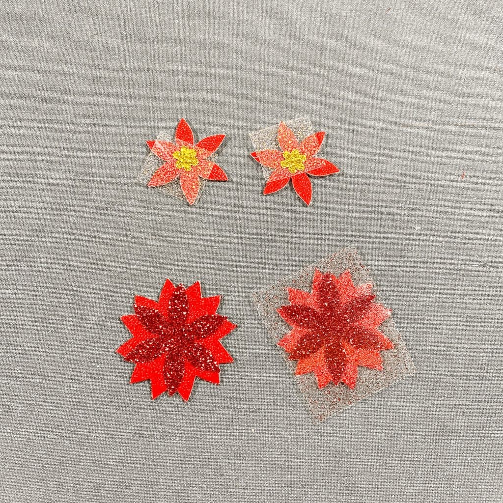 poinsettia earrings faux leather and glitter HTV