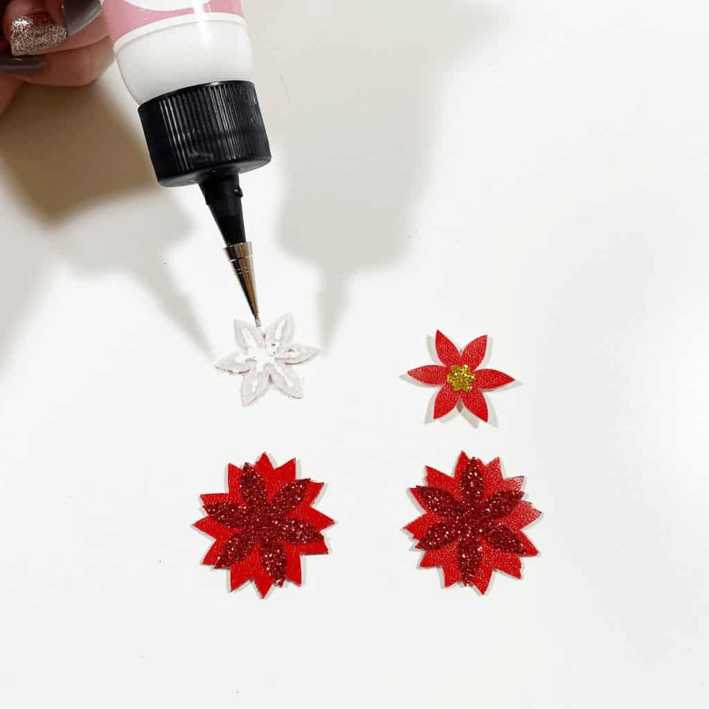 gluing poinsettia earrings