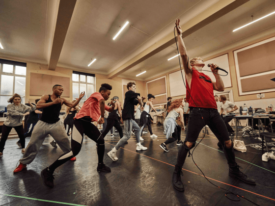 Andrew Polec and the cast in rehearsals for BAT OUT OF HELL, credit Specular