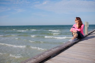 Amy West sitting on fishing pier on Anna Maria Island