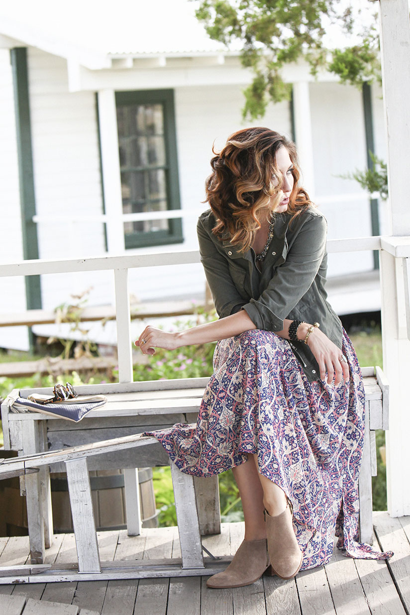 Amy West in military jacket and bohemian maxi skirt