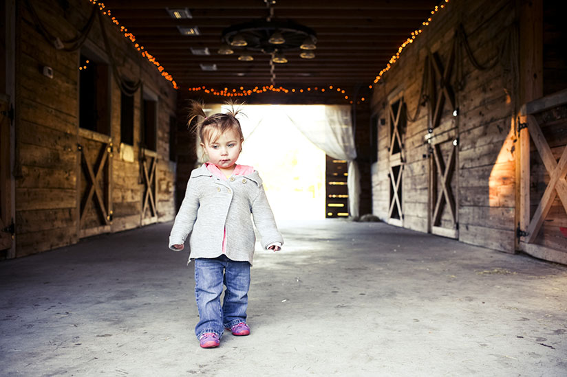 Little girl makes her way through Horse Stamp Inn