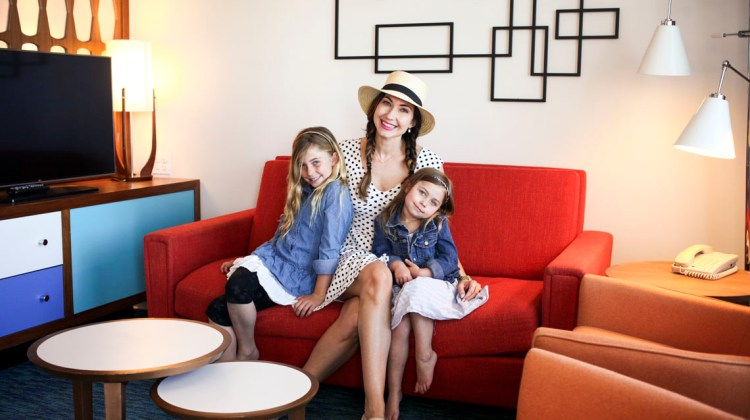 Travel Blogger Amy West and family pose for the camera in their Cabana Bay hotel room
