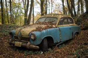 Old, beat-up car to show that things (and concepts) become outdated.