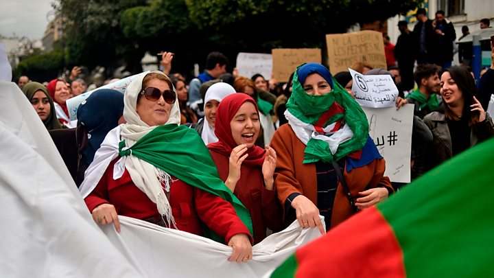 "Thousands of protesters rallied peacefully in Algiers after Friday prayers, chanting ""We will not shut up!"" and demanding the departure of Algeria's ruling elite a month after the downfall of President Abdelaziz Bouteflika."