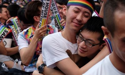 Thousands of marriage-equality advocates celebrated Friday in the pouring rain outside Taiwan's legislature as it voted to become the first in Asia to fully legalize same-sex unions.