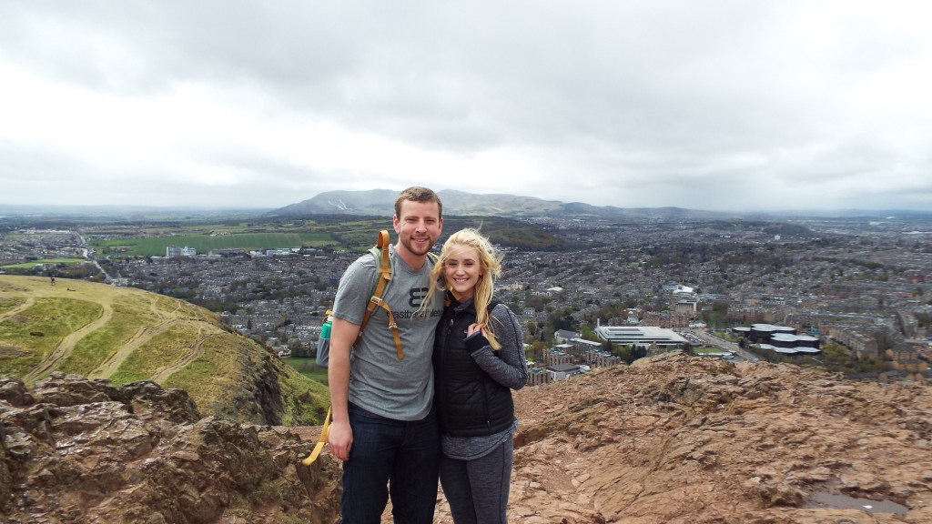 At the top of Arthur's Seat with Edinburgh in the background. We only lasted about ten minutes before the wind and rain chased us down.