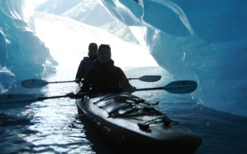 Kayaking through a glacier tunnel.