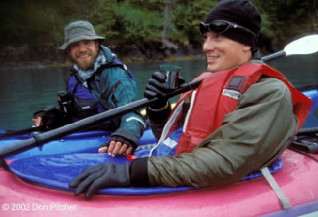 Guides Ryan Morrill and Paul Nylund share a hot beverage and a laugh on the water. 2001.