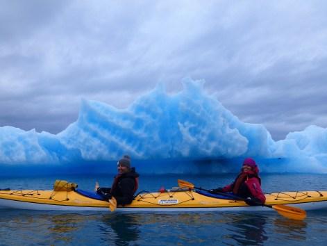 The Face Of Columbia Glacier Iceberg Paddling In Bay Sea