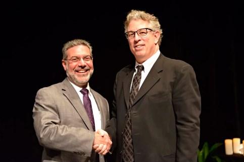 Dr. Steven Girelli thanking Bruce Perry, M.D., Ph.D.