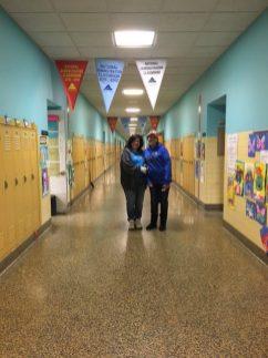 Teachers in School Hallway