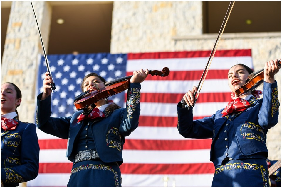 Julian Castro rally in San Antonio, mariachi plays in front of American flag