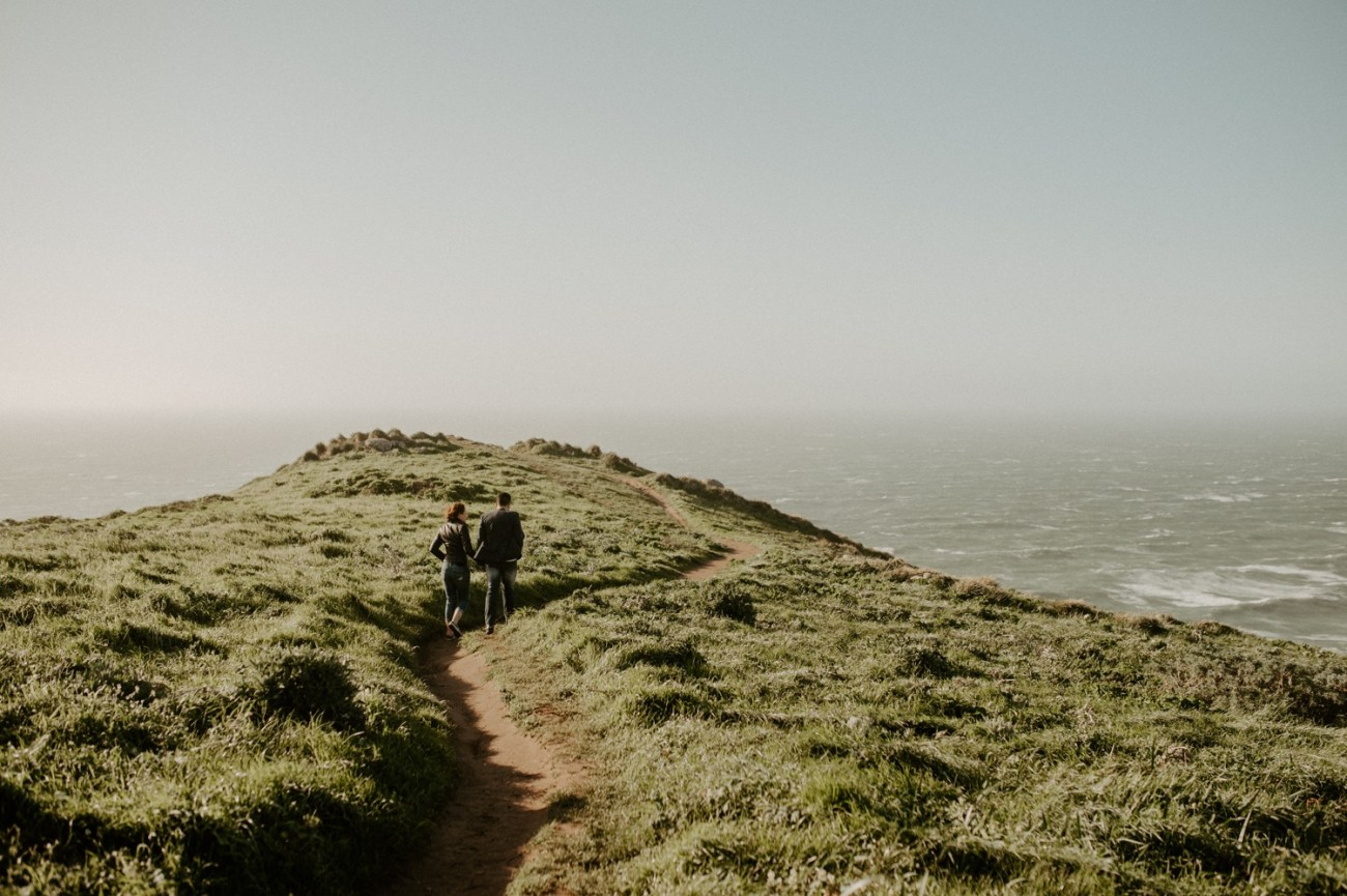 Couple walking on South Beach Overlook in Point Reyes California for their engagement photos