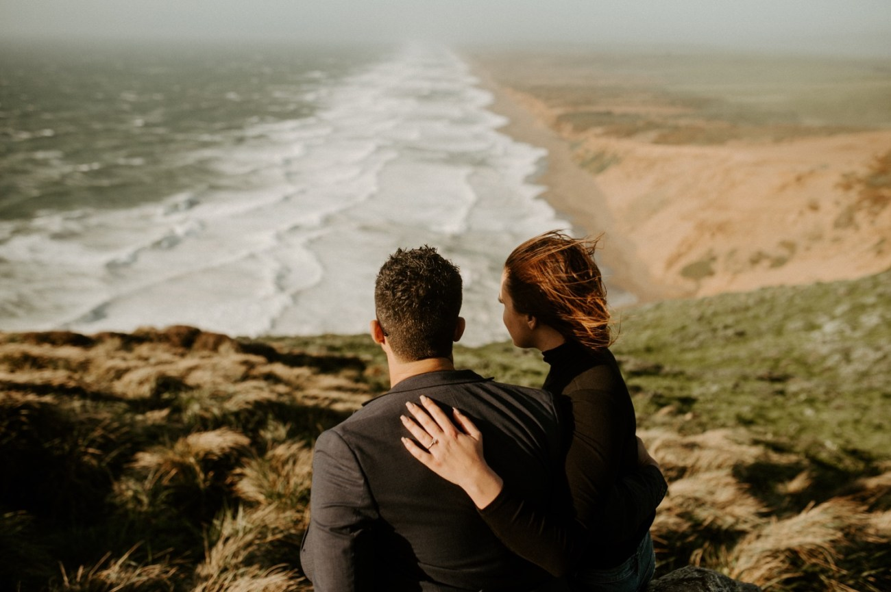 Couple looking away at the South Beach Overlook in Point Reyes California, San Francisco Wedding Photographer, Anais Possamai Photography