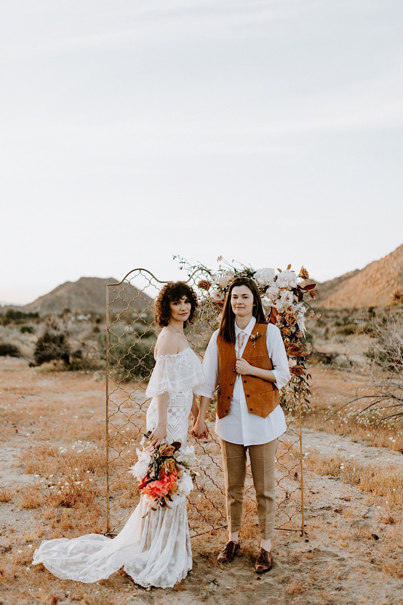 Elopement Ceremony set up in Joshua Tree, couple exchanging vows in Joshua Tree