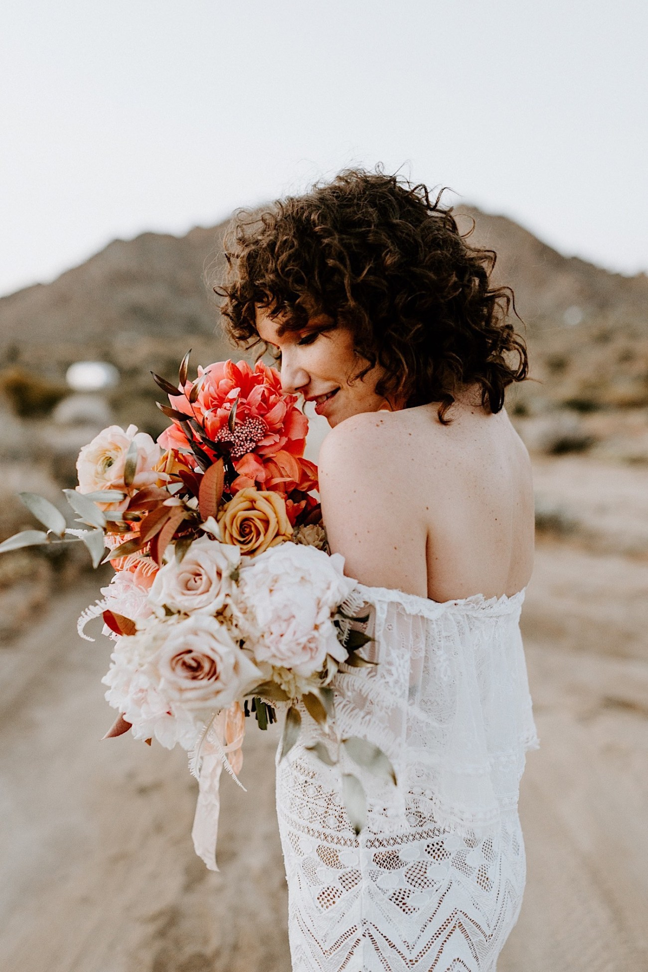Colorful pink and corals wedding bouquet for your Boho Joshua Tree Elopement