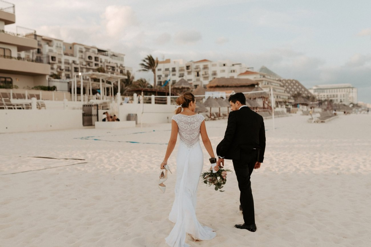 Bride and Groom walking on the beach in Cancun at the Fiesta Americana Conseda Hotel
