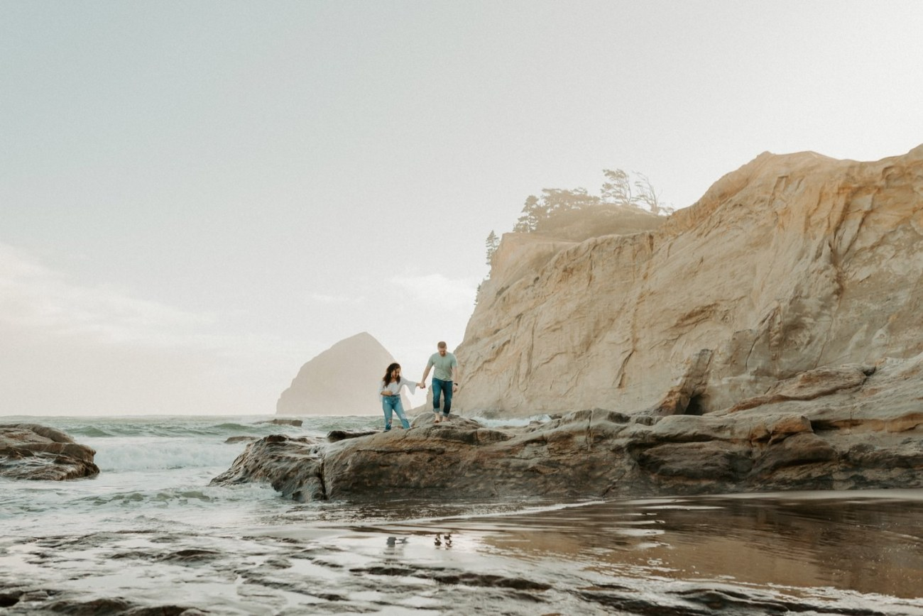 Couple walking on the rocks at Cape Kiwanda Beach. Cape Kiwanda Pacific City Oregon Couple Session Portland Wedding Photographer 012