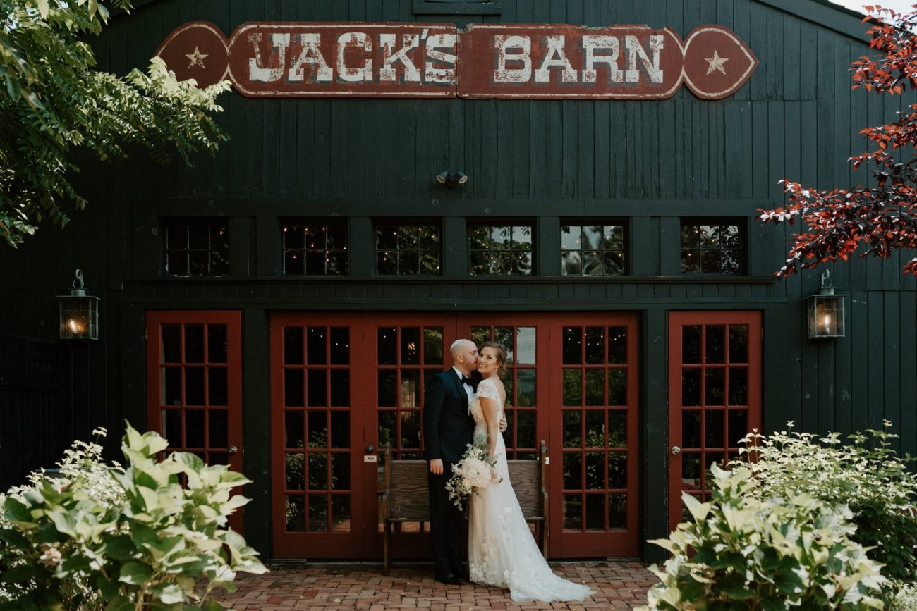 Bride and Groom standing in front of Jacks Barn Oxford New Jersey Wedding Venue. New Jersey Wedding Photographer NJ Wedding Venue Rustic Barn Wedding Anais Possamai Photography 020