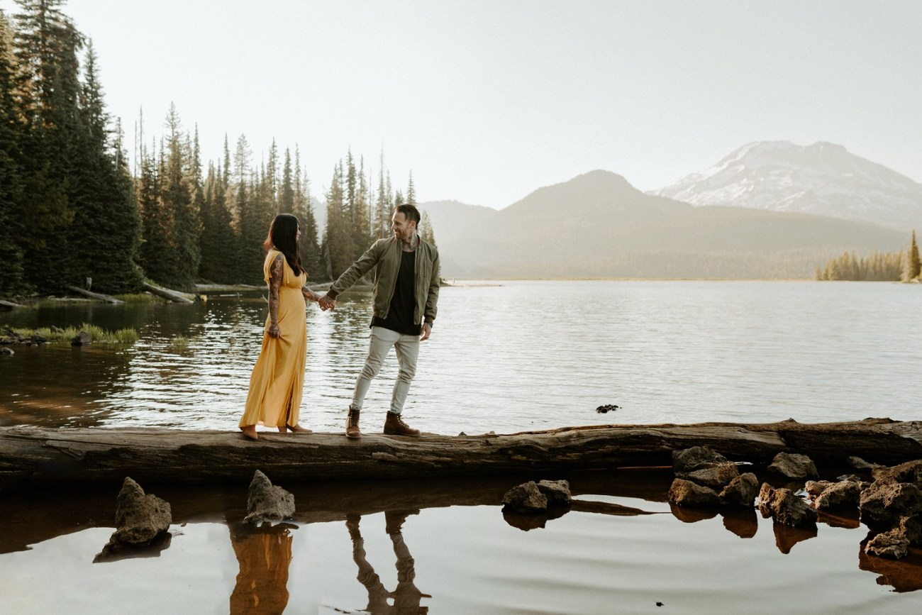 Couple walking by Sparks Lake for their couple session. Bend Oregon Elopement, Bend Wedding Photographer Anais Possamai Photography