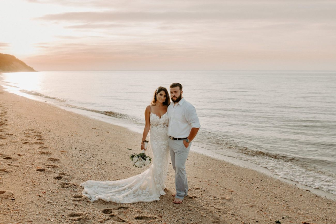 Bride and Groom standing on the beach at Sunken Meadow State Park in Long Island for their sunset Wedding Bridal Portrait. New York Wedding Photographer. Anais Possamai Photography