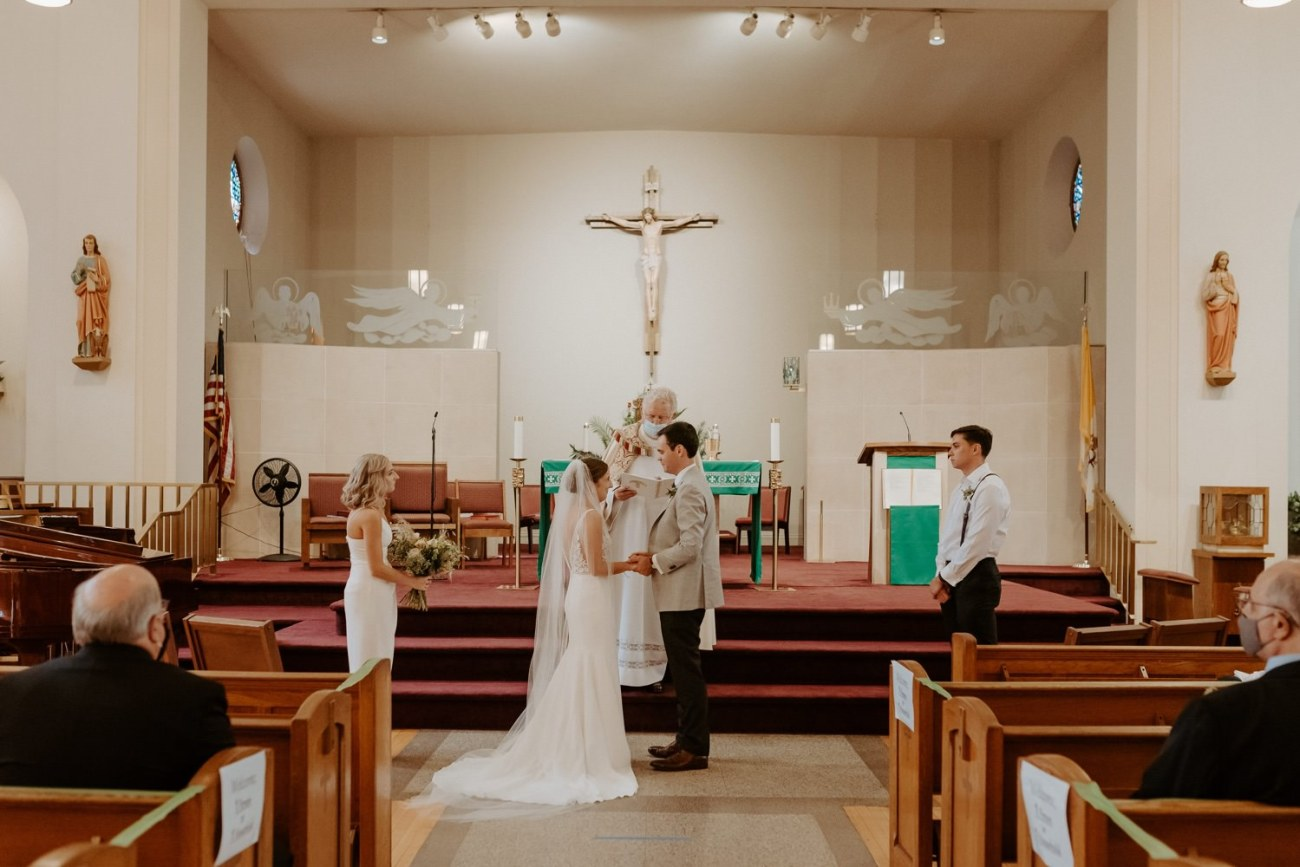 Bride and Groom standing in church for their ceremony. Antique Loft Hoboken Wedding New Jersey Wedding Photographer Anais Possamai Photography 028