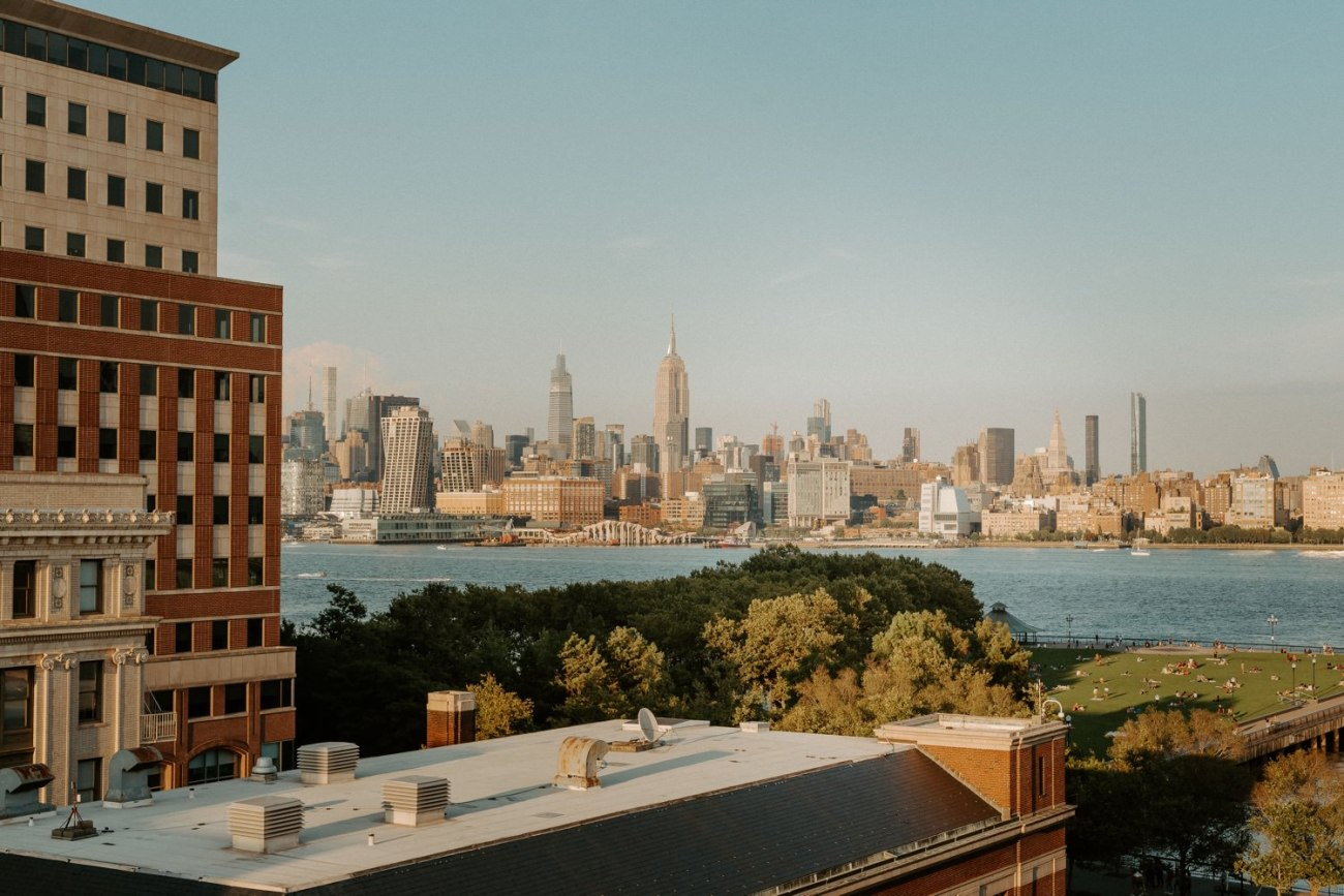 View over the New York City Skyline from the Antique Loft Hoboken Wedding Venue. New Jersey Wedding Photographer Anais Possamai Photography 047
