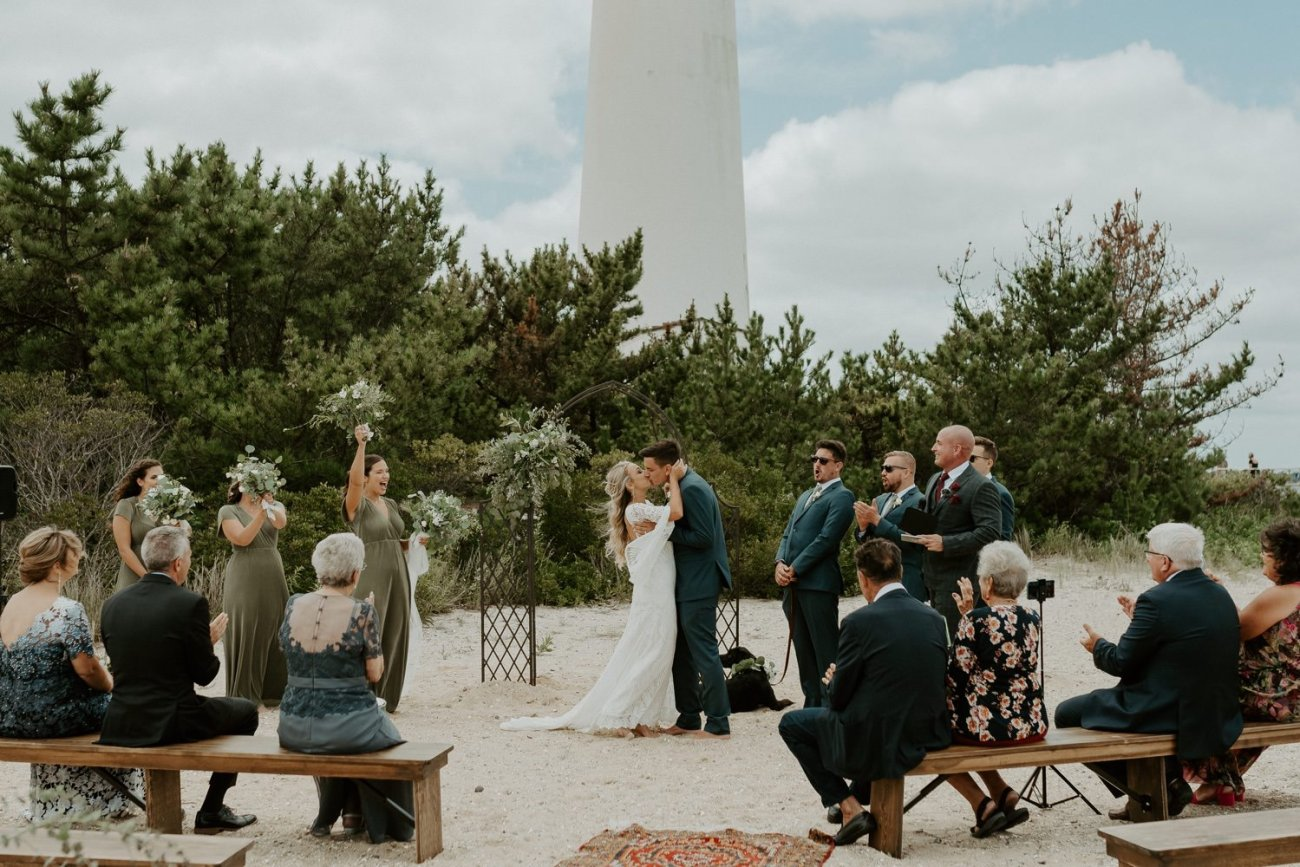 Bride and Groom first kiss during their ceremony at the Barnegat Lighthouse in Long Beach Island New Jersey