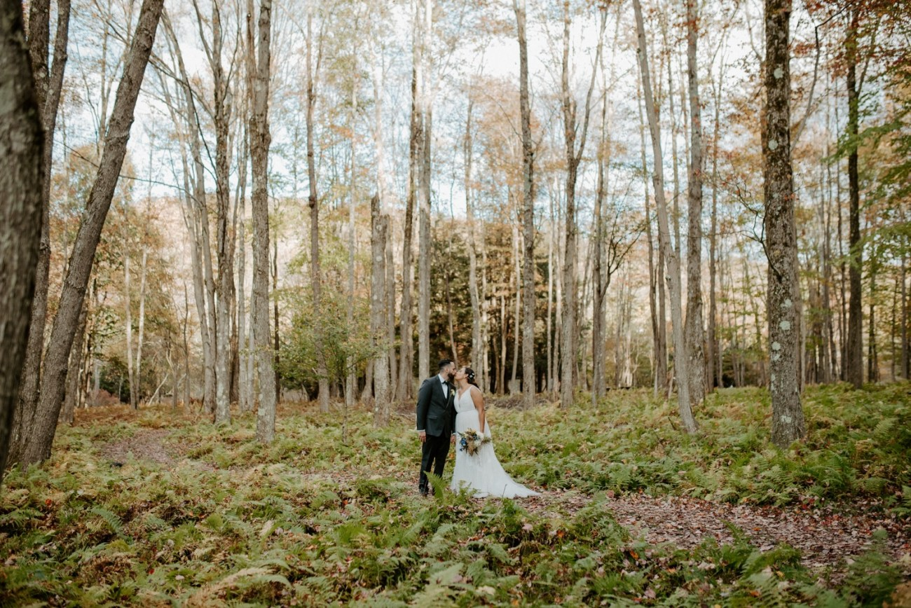 Bride and Groom walking through the forest at Handsome Hollow wedding venue. Anais Possamai Photography