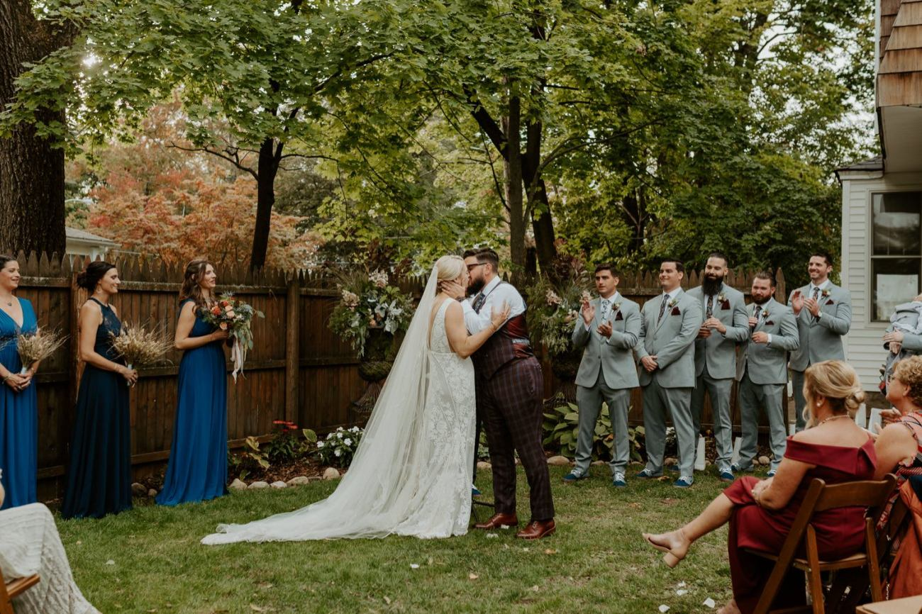 Bride and Groom first kiss at their backyard wedding ceremony