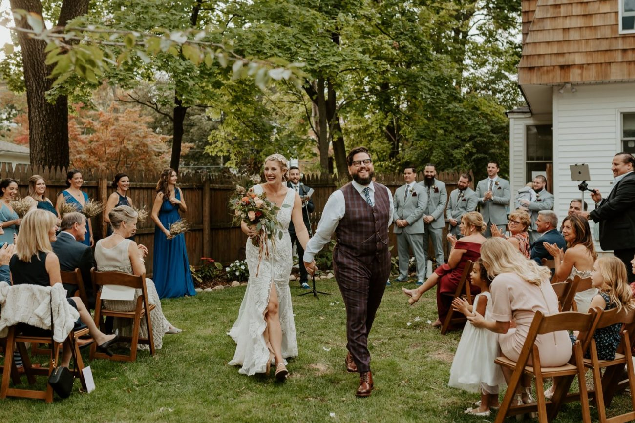 Bride and Groom walking down the aisle at their backyard wedding ceremony