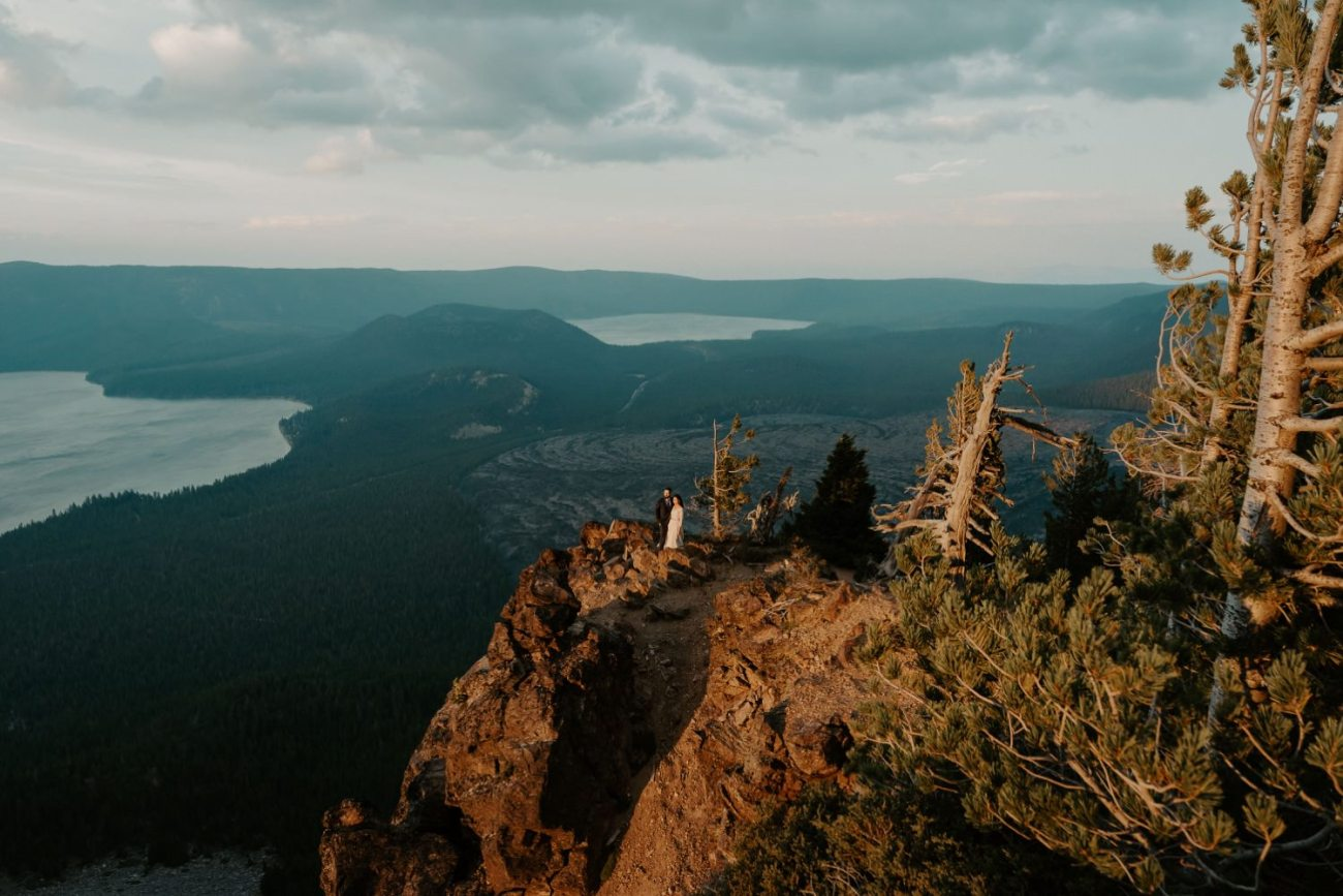 Sunset elopement photos of bride and groom on top of the Newberry Volcano in Bend Oregon