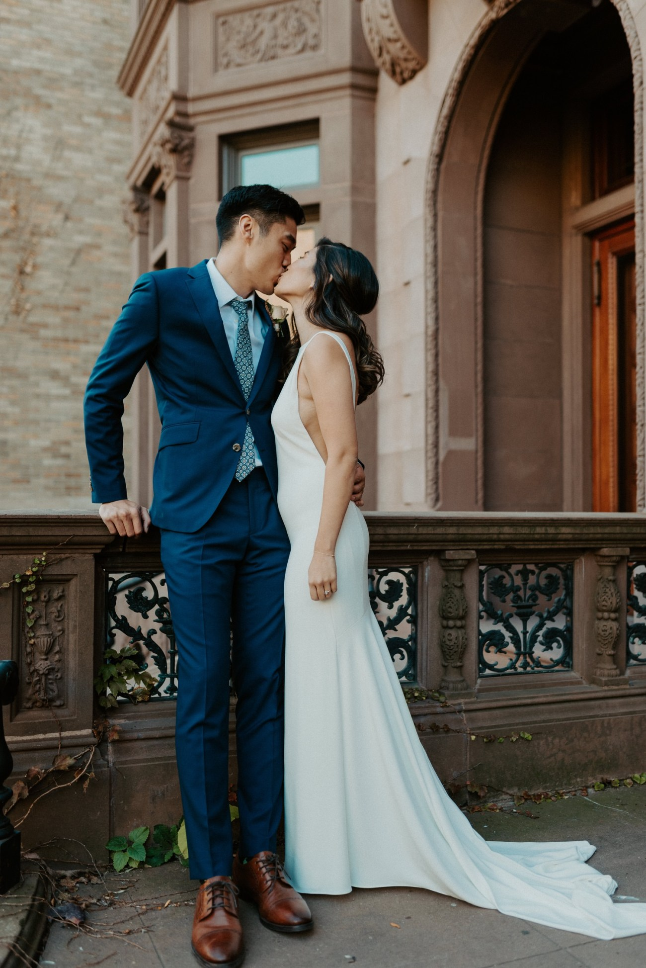 Bride and Groom first look on top of the stairs of their Brownstone House Venue in Brooklyn