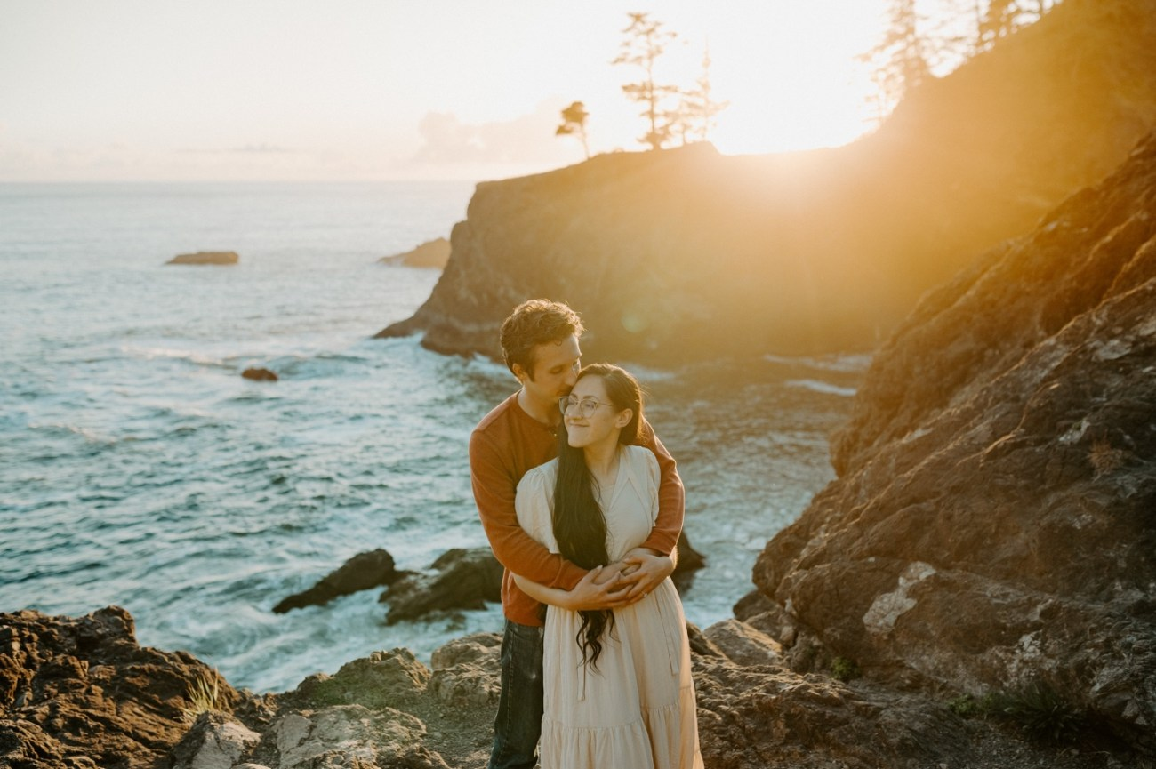 Couple standing on the cliffs of the souther Oregon Coast in Samuel H Boardman during sunset