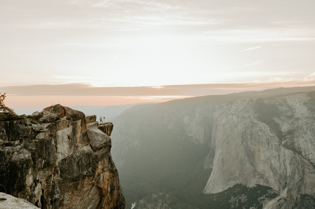 Couple standing in Taft Point with El Capitan in the background in Taft Point Yosemite National Park