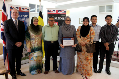 British High Commissioner David Campbell with Siti Nurfateha Abdullah and her family